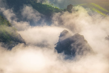 Wall Mural - Morning mist over mountains.