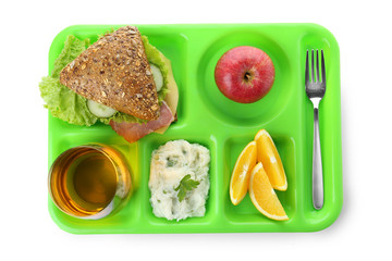 Serving tray with healthy food on white background, top view. School lunch