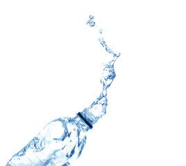 Water splash from bottle on white background