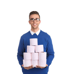 Young man holding toilet paper rolls on white background