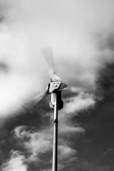 wind turbine spinning, black and white