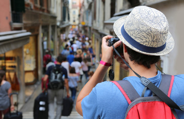 photographer with hat takes some picutres