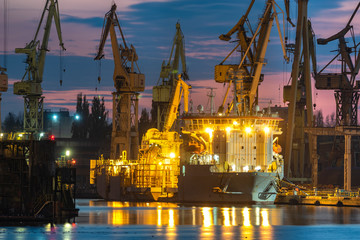 industrial areas, shipyard and port after sunset - Szczecin, Poland