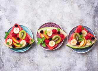 Watermelon pizza with fruit and berries