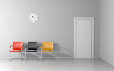 Three crairs and wall clock in the waiting room