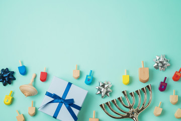 Jewish holiday Hanukkah background with menorah,  gift box and spinning top