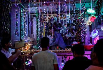 Customers shop for decorative lights ahead of the Hindu festival of Diwali in Mumbai