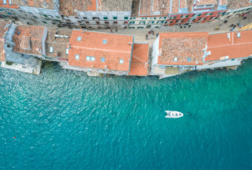 Overhead view of boat moving in sea near houses at Rovinj