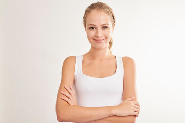 Smiling young woman studio portrait