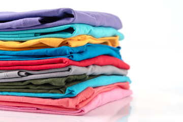 Stack of Colorful cotton T-shirt isolated on white background.