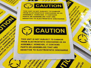 "Yellow caution label,Standard caution label with text ""Caution"" for Electrostatic Sensitive Devices (ESD) in electronic industrial,Special label symbol for electrostatic sensitive devices"