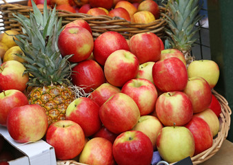 fresh apples and pineapples at the Borough market in London city United Kingdom
