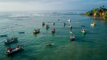 Beautiful aerial view of fishing boats and coastline