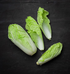 Romain lettuce on wooden table,Top view