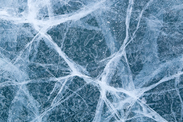 cracked texture of ice on Baikal lake, Winter