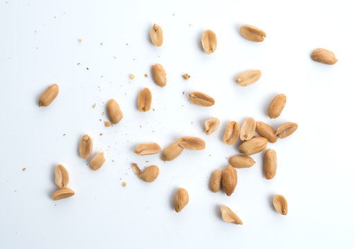Roasted salted peanuts isolated on a white background