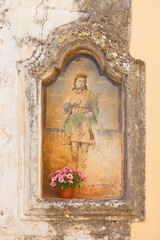 Presicce, Apulia - An old religious wall painting in the streets of Presicce