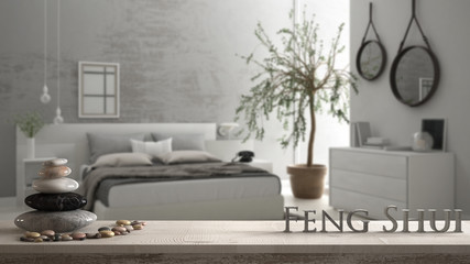 Obraz Wooden vintage table shelf with pebble balance and 3d letters making the word feng shui over blurred bedroom with window, chest of drawer and big olive tree, zen concept interior design - fototapety do salonu