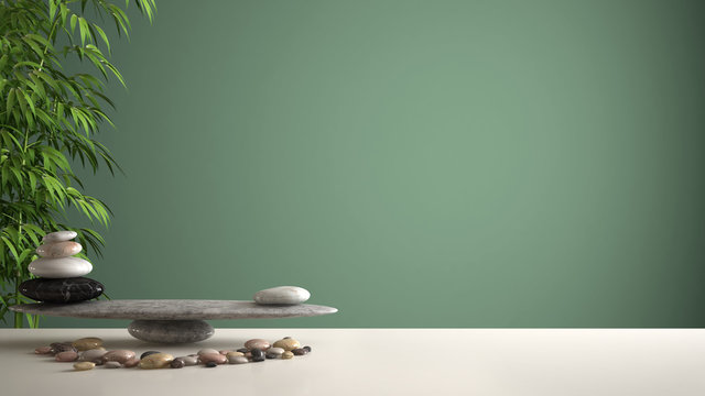 Empty interior design feng shui concept zen idea, white table or shelf with pebble balance and green bamboo, over green background copy space