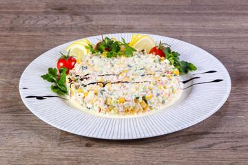 Salad with crab surimi