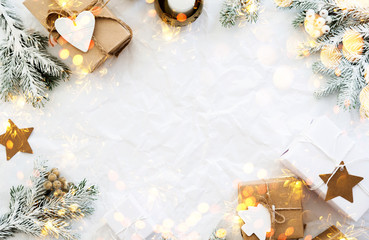 Christmas and New Year holiday background. Xmas greeting card. Christmas gifts on white background top view. Flat lay. Glitter bokeh lights