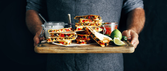 hands man cutting board vegetarian snacks quesadilla vegetables cheese