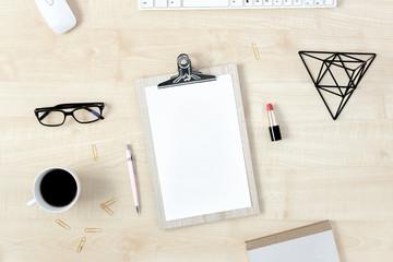 Feminine workspace сlipboard and accessories top view