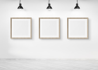 Three squared frames hanging on a wall mockup 3d rendering