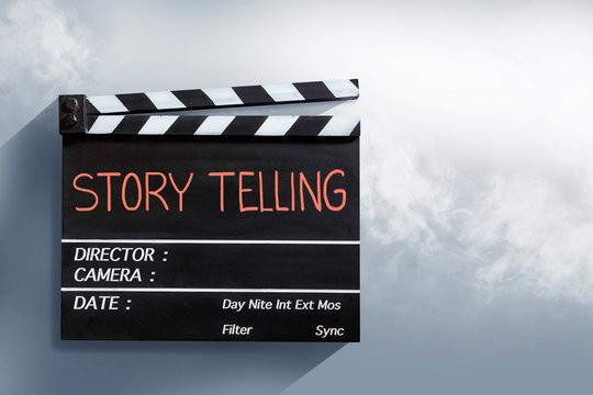 Story telling , red text title on movie Clapper board