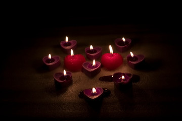 candles are burning purple and red on a white background