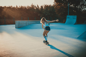 Beautiful skater girl lifestyle moments in a skatepark