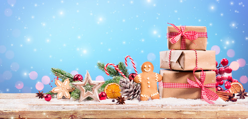 Christmas Decoration - Gift And Gingerbread With Ornament On Table