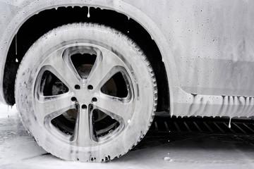 Car in foam.  Car washing concept. Autowashing. Cleaning of the car on car wash