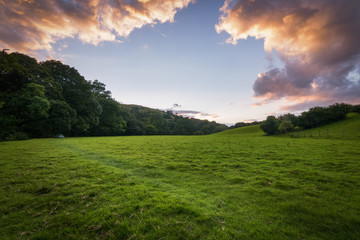 Camping tent in the green and lush meadows of England at sunset
