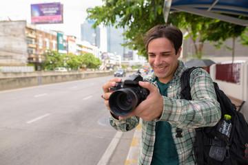 Tourist photographer man exploring the city of Bangkok
