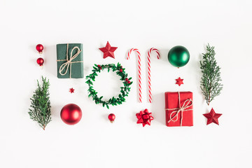 Christmas composition. Gifts, fir tree branches, red decorations on white background. Christmas, winter, new year concept. Flat lay, top view