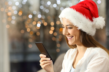 Woman sending christmas messages on phone