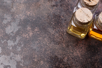 olive oil and vinegar bottles on a rustic background