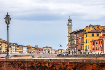 monuments and buildings in Pisa on the Arno river in Tuscany