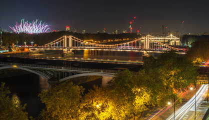 High Resolution Panorama of the Chelsea Bridge in London from Battersea Park at night and the fireworks