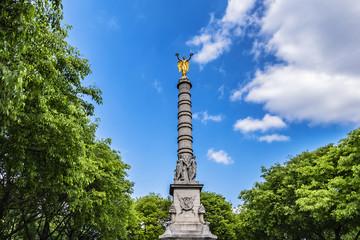 Paris Fontaine du Palmier (or Fontaine de la Victoire, 1806 - 1808) at Place du Chatelet - monumental fountain to celebrate victories of Napoleon Bonaparte with goddess Victory at top. Paris, France.