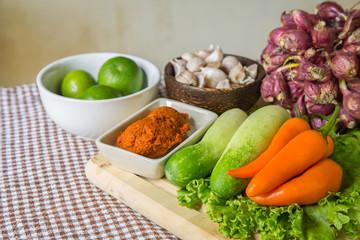 Fresh herbs and spices (chili, pepper, lettuce, lemon, cucumber, shallot)