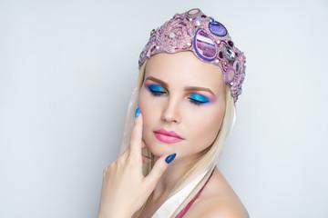 woman blue pink make up