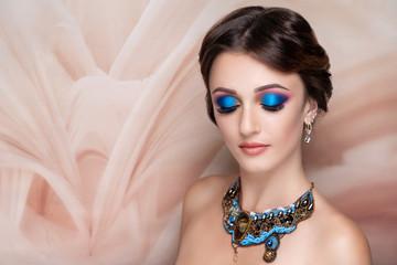 woman bright blue make up