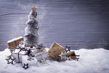 Christmas tree and gift boxes in magic snow landscape