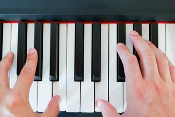 Musician playing a piano keyboard