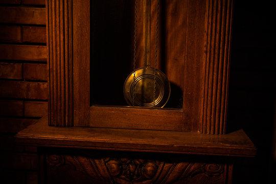 Vintage interior in western style. Big wooden antique clock with pendulum.