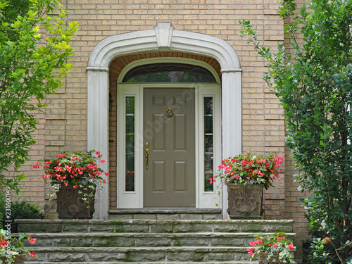 Front Door With Sidelights And Transom Window On Brick