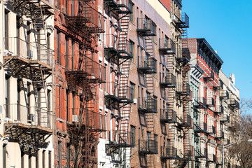 Fototapete - Repeating pattern of fire escapes on colorful old buildings along St. Marks Place in New York City