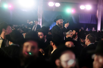 Rabbis take videos of the crowd as others dance at a banquet for the International Conference of Shluchim (emissaries) of the Chabad-Lubavitch movement in Suffern, NY